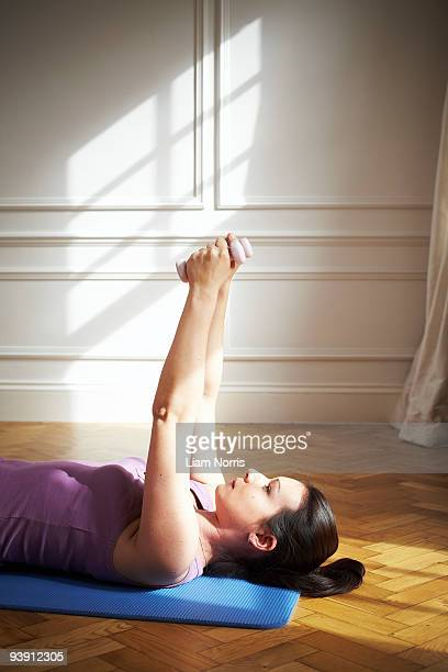 Woman using weights. Pilates.