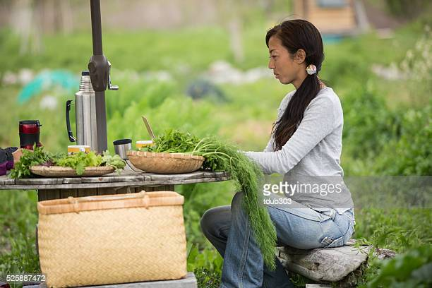 Woman using wireless technology at small business herb farm