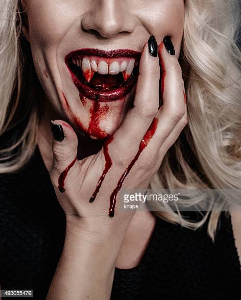 Woman vampire with scary blood for halloween