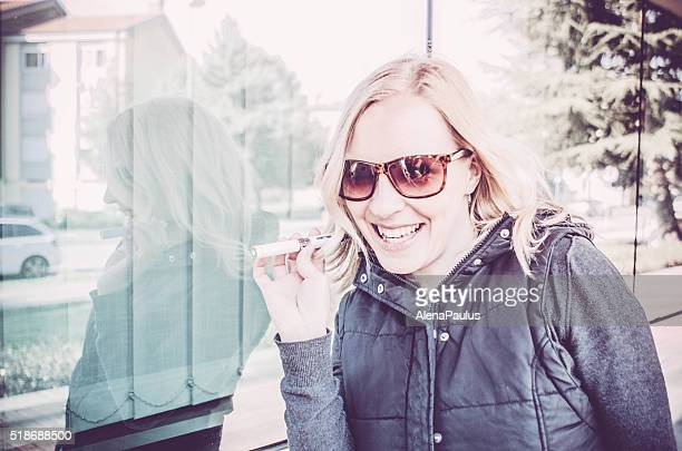 Woman vaping outdoors, people using electronic cigarettes in daily life