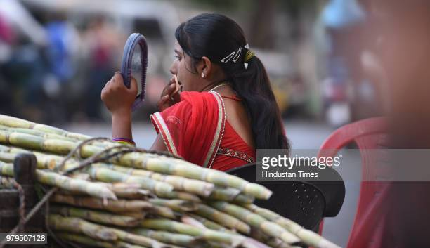 A woman vendor serves sugarcane juice to customers on May 17 2018 in Kota India An estimate of 8001000 women hailing from Rajasthans Tonk district...