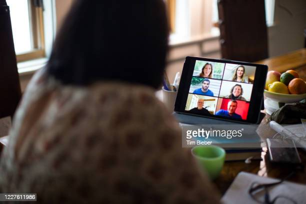 woman video calling with friends or coworkers - leanincollection stock pictures, royalty-free photos & images