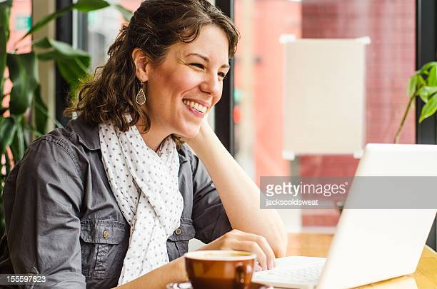 woman video chatting in a coffee shop - webcam stock photos and pictures