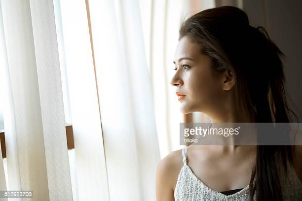 Woman viewed through window