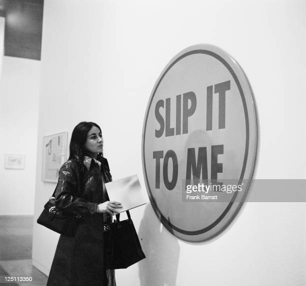 A woman viewing 'Epiphany' at a preview of the first full retrospective exhibition of works by British pop artist Richard Hamilton at the Tate...