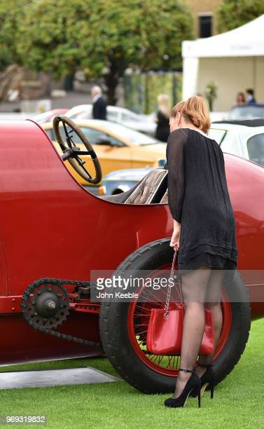 Woman views a 1911 Fiat S76 on display at the London Concours at the Honourable Artillery Company on June 7, 2018 in London, England. The event...