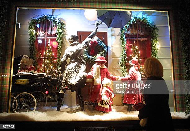 Woman views a Christmas display outside the Bergdorf Goodman store December 4, 2001 in New York City. New York is in full holiday swing as the city...