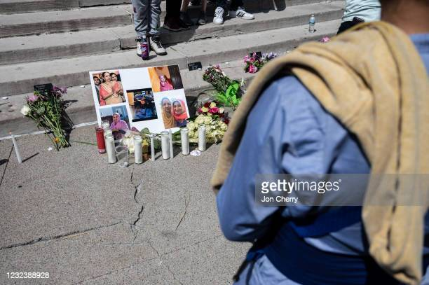 Woman views a collage of photos of Amarjeet Johal during a vigil at Monument Circle in on April 18, 2021 in Indianapolis, Indiana. The vigil was held...