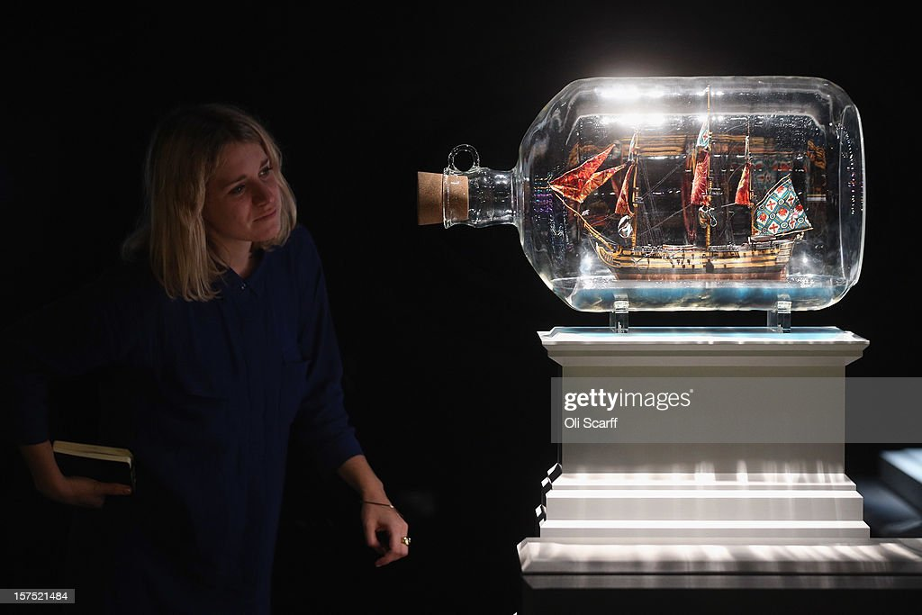 A woman views a maquette for the Fourth Plinth proposal by Yinka Shonibare entitled 'Nelson's Ship in a Bottle' which features in the exhibition 'Fourth Plinth: Contemporary Monument' at the ICA on December 4, 2012 in London, England. The exhibition at the Institute of Contemporary Arts features maquettes by artists including Tracy Emin, Antony Gormley, Anish Kapoor, it opens tomorrow and runs until January 20, 2013.