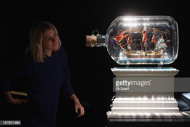 A woman views a maquette for the Fourth Plinth proposal by Yinka Shonibare entitled 'Nelson's Ship in a Bottle' which features in the exhibition...