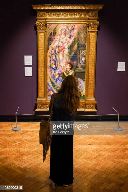 Woman views a painting as she visits the Evelyn and William De Morgan exhibition as the Laing Art Gallery re-opens to the public on August 10, 2020...