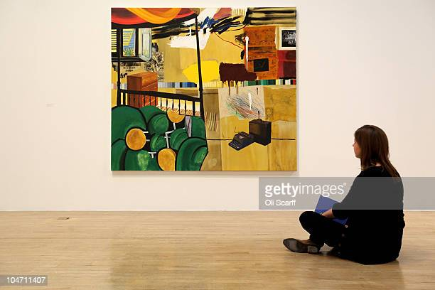 A woman views a painting by Dexter Dalwood entitled 'Burroughs in Tangiers' which has been shortlisted for the Turner Prize 2010 and are displayed in...