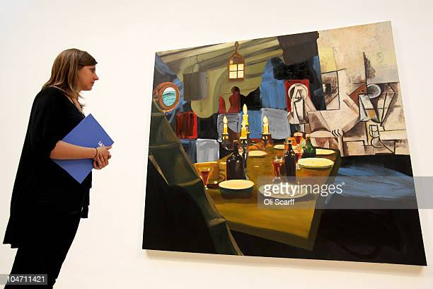 A woman views a painting by Dexter Dalwood entitled 'Herman Melville' which has been shortlisted for the Turner Prize 2010 and are displayed in the...