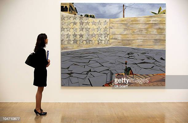 A woman views a painting by Dexter Dalwood entitled 'White Flag' which has been shortlisted for the Turner Prize 2010 and are displayed in the Tate...