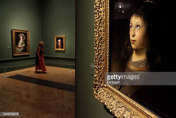 A woman views a painting on display in the exhibition 'Treasures from Budapest' at the Royal Academy of Arts on September 21 2010 in London England...