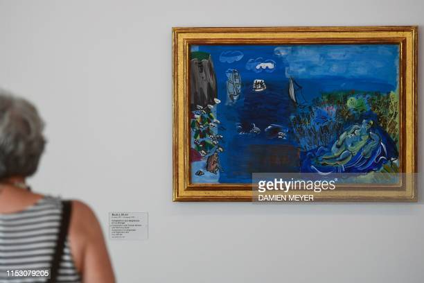 A woman views a Raoul Dufy painting Composition aux baigneuses et nu allonge at the MuMa Andre Malraux Museum of Modern Art in Le Havre on June 28...