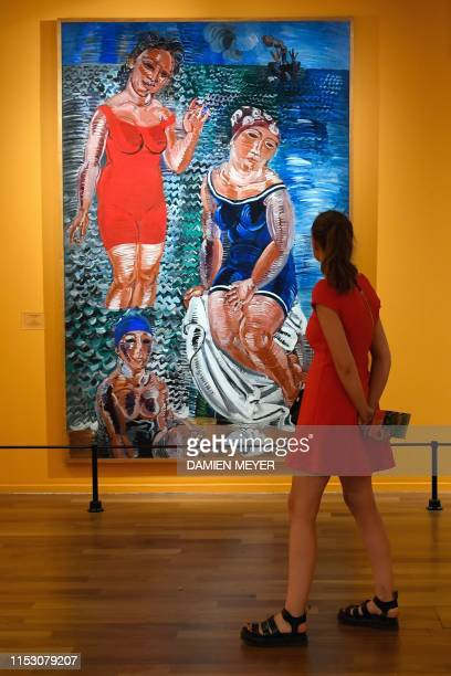 A woman views a Raoul Dufy painting Les trois baigneuses at the MuMa Andre Malraux Museum of Modern Art in Le Havre on June 28 during an exhibition...