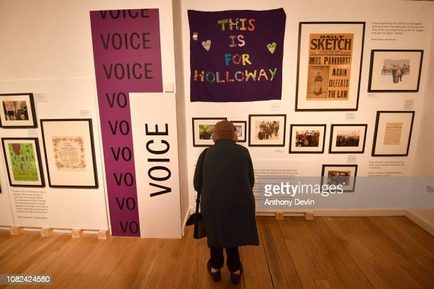 A woman views a Suffragette exhibition on display in the People's History Museum ahead of the unveiling of a statue of the suffragette Emmeline...
