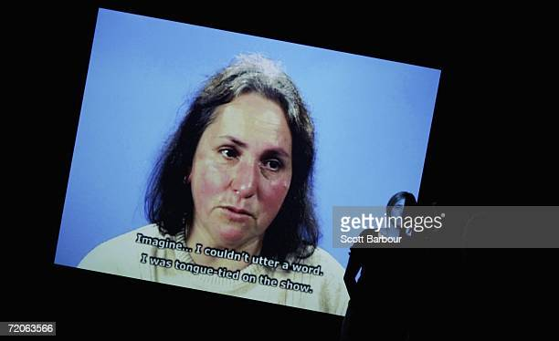 A woman views a video installation by artist Phil Collins titled 'the return of the real/gercecegin geri donusu 2005' in which the artist invited...