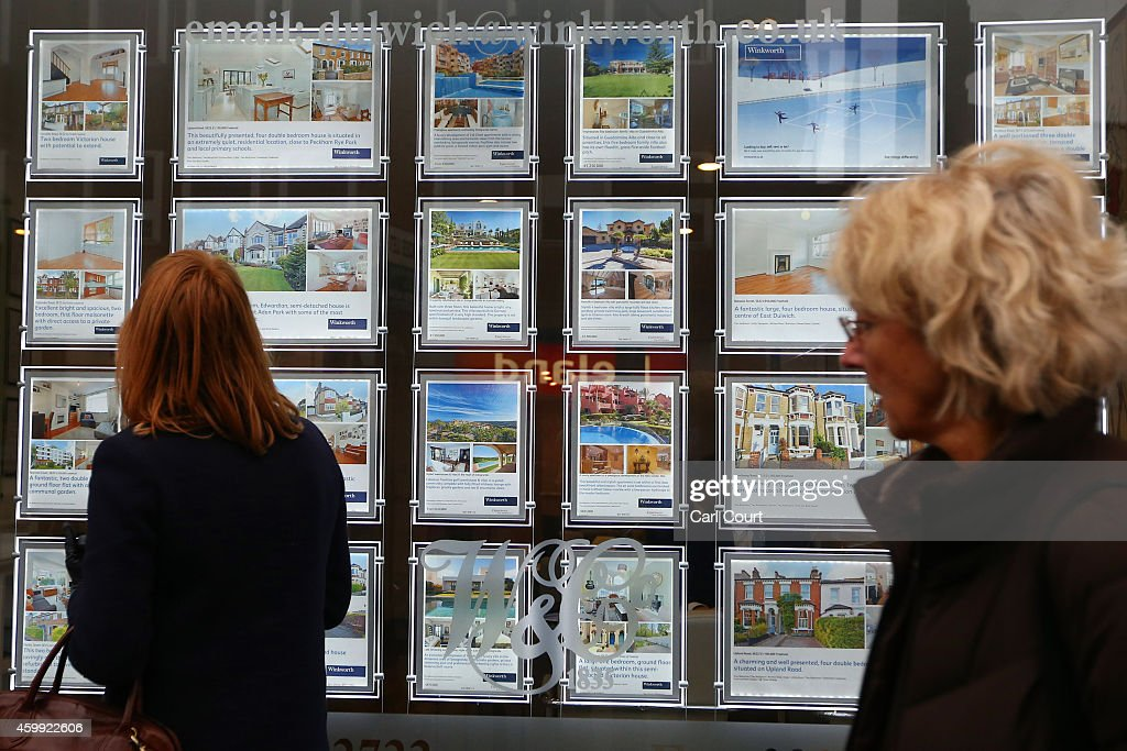 A woman views adverts in the window of an estate agents on December 4, 2014 in in East Dulwich, London, England. In his autumn statement, Chancellor of the Exchequer, George Osborne, cut the rate of stamp duty for lower-value house sales and raised it on those worth more than £1.5m in a move that would cut the rate of tax for 98% of house purchases.