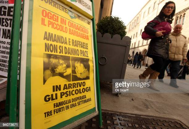 A woman views an advert in Perugia town centre for the Italian newspaper 'Corriere dell' Umbria' report on the conviction of Amanda Knox and Raffaele...