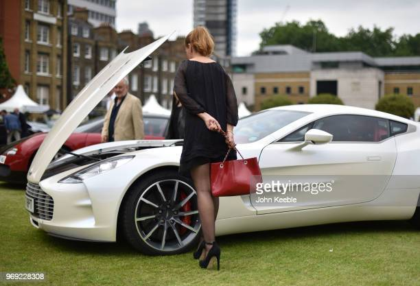 Woman views an Aston Martin on display at the London Concours at the Honourable Artillery Company on June 7, 2018 in London, England. The event...