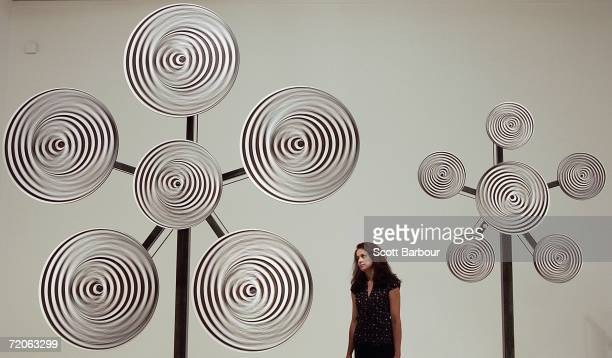 A woman views an installation by artist Mark Titchner titled 'Ergo Ergot' during a preview of The Turner Prize 2006 at the Tate Britain on October 2...