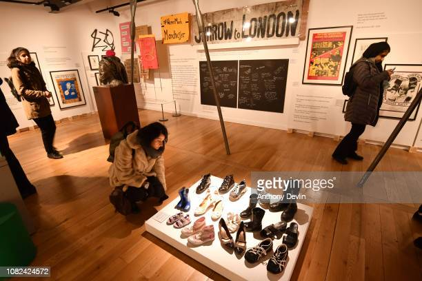 A woman views an installation titled ' If You Wear My Shoes Then You'll Know' by Safety4Sisters on display in the People's History Museum ahead of...