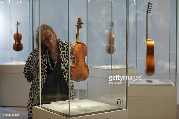 A woman views an instrument made by Antonio Stradivari on show at the exhibition 'Stradivarius' at the Ashmolean museum on June 12 2013 in Oxford...