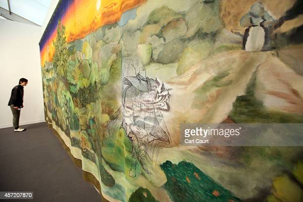 A woman views an work by artist Friedrich Kunath entitled 'What Difference It Makes When It Doesn't Make Any Difference Anymore' during the VIP and...