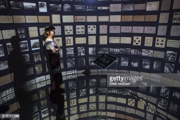 A woman views historical documents and photographs displayed in a high tech art installation at Salt Galata on May 6 2017 in Istanbul Turkey The...