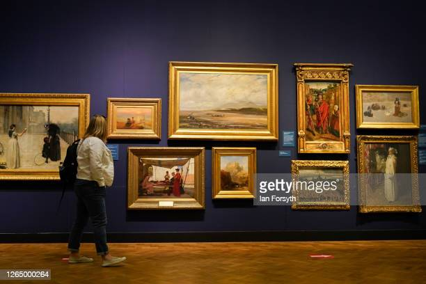 Woman views paintings as the Laing Art Gallery re-opens to the public on August 10, 2020 in Newcastle upon Tyne, England. As Coronavirus pandemic...