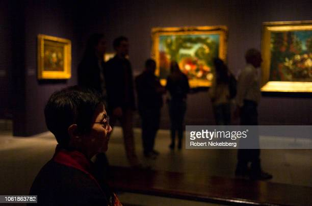 Woman views paintings at the exhibition of French painter Eugéne Delacroix October 14, 2018 at The Metropolitan Museum of Art in New York City. The...