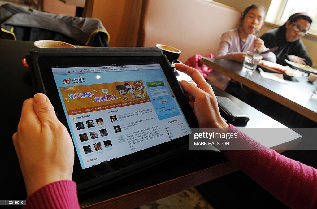 A woman views the Chinese social media website Weibo at a cafe in Beijing on April 2, 2012. China's move to shut down websites and curb rumours of a political coup reveal growing nervousness ahead of the nation's first leadership transition in the social media age. The crackdown on the media and Internet is likely to remain in force until President Hu Jintao and other top leaders step down from their Communist Party posts late this year in a 10-yearly leadership change. AFP PHOTO/Mark RALSTON