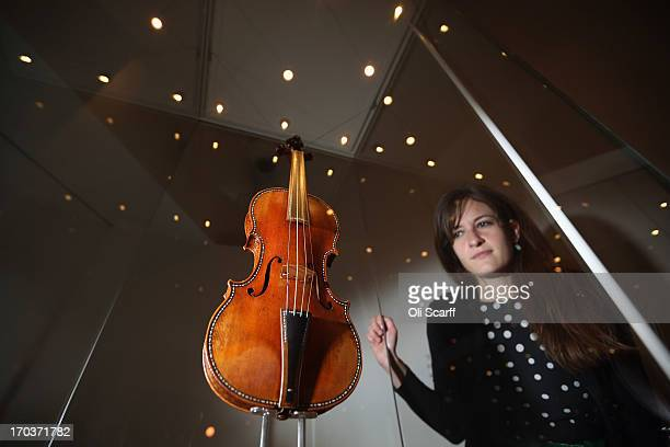A woman views 'The Cipriani Potter' violin made by Antonio Stradivari in 1683 on display in the exhibition 'Stradivarius' at the Ashmolean museum on...