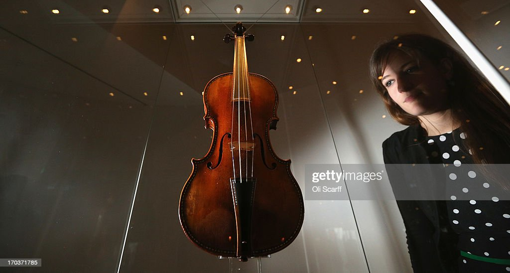 A woman views 'The Cipriani Potter' violin made by Antonio Stradivari in 1683 on display in the exhibition 'Stradivarius' at the Ashmolean museum on June 12, 2013 in Oxford, England. The exhibition, which is the first major show of Stradivarius instruments in the UK, brings together 21 violins and cellos and runs until August 11, 2013.
