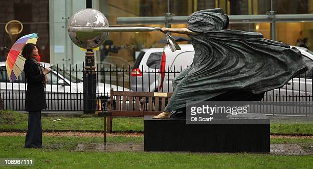 A woman views 'The Force of Nature II' by contemporary sculptor Lorenzo Quinn installed in Berkeley Square by Halcyon Gallery on February 10 2011 in...