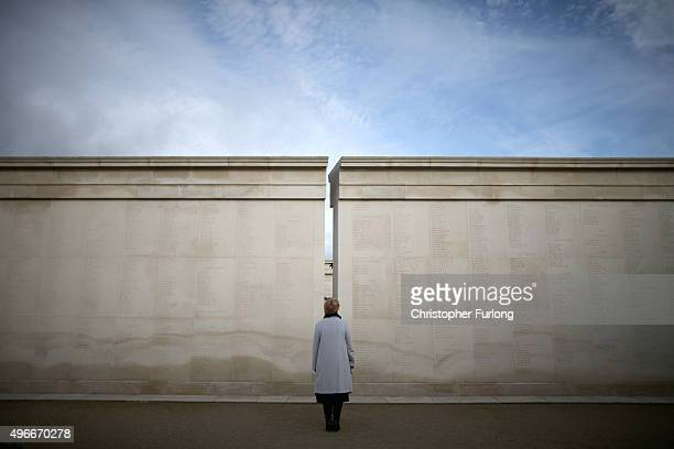 Woman views the names of fallen soldiers during the annual Armistice Day Service at the Armed Forces Memorial at the National Memorial Arboretum on...