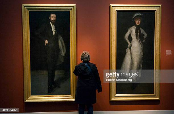 Woman views two portraits painted by the American artist James McNeill Whistler March 18, 2015 at the Freer Gallery of Art in Washington, DC. On the...