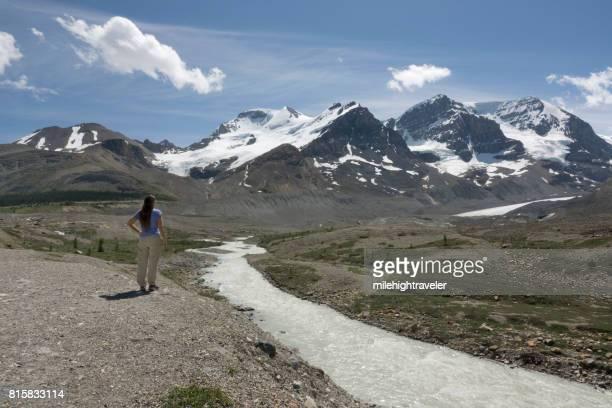Woman views Winston Churchill Range Sunwapta River Jasper National Park Alberta