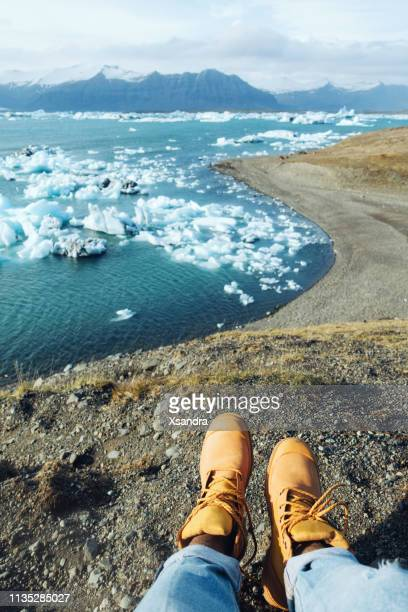 woman visiting jokulsarlon glacier lagoon - ice floe stock pictures, royalty-free photos & images