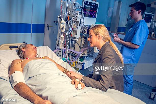 Woman visiting man in hospital