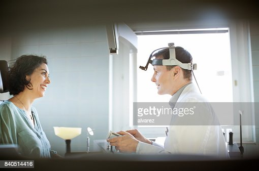 Woman visiting otolaryngologist doctor