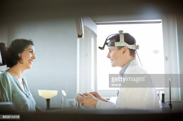 Woman visiting otolaryngologist doctor