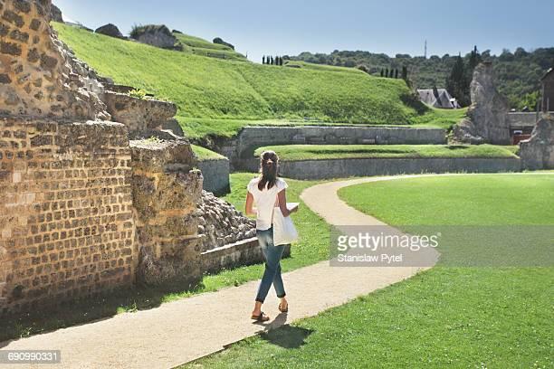Woman visiting ruins