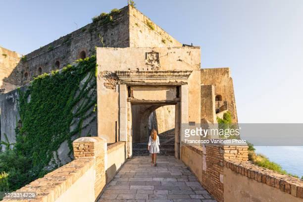 woman visiting the old town of scilla, calabria, italy. - sud foto e immagini stock