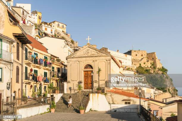 woman visiting the old town of scilla, calabria, italy. - レッジョカラブリア ストックフォトと画像
