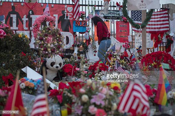 A woman visits a makeshift memorial near the Inland Regional Center in San Bernardino California December 21 2015 Enrique Marquez who is alleged to...