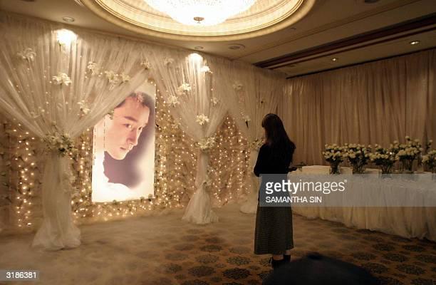 A woman visits a memorial shrine to the late Hong Kong film star and singer Leslie Cheung at the Mandarin Oriental hotel in Hong Kong 01 April 2004...
