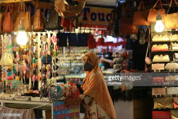 A woman visits a shop ahead of EidulFitr after shopping malls reopen on a limited scale during the lockdown as a preventive measure against the...